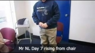 Mr NL Day 7 rising from chair