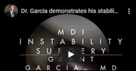 Dr. Garcia demonstrates his stabilization technique for multidirectional instability